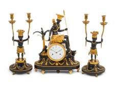 A French Gilt and Patinated Bronze ThreePiece Clock