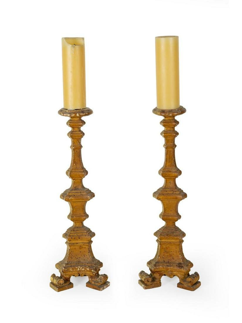 A Pair of Italian Giltwood Prickets Height 25 inches.