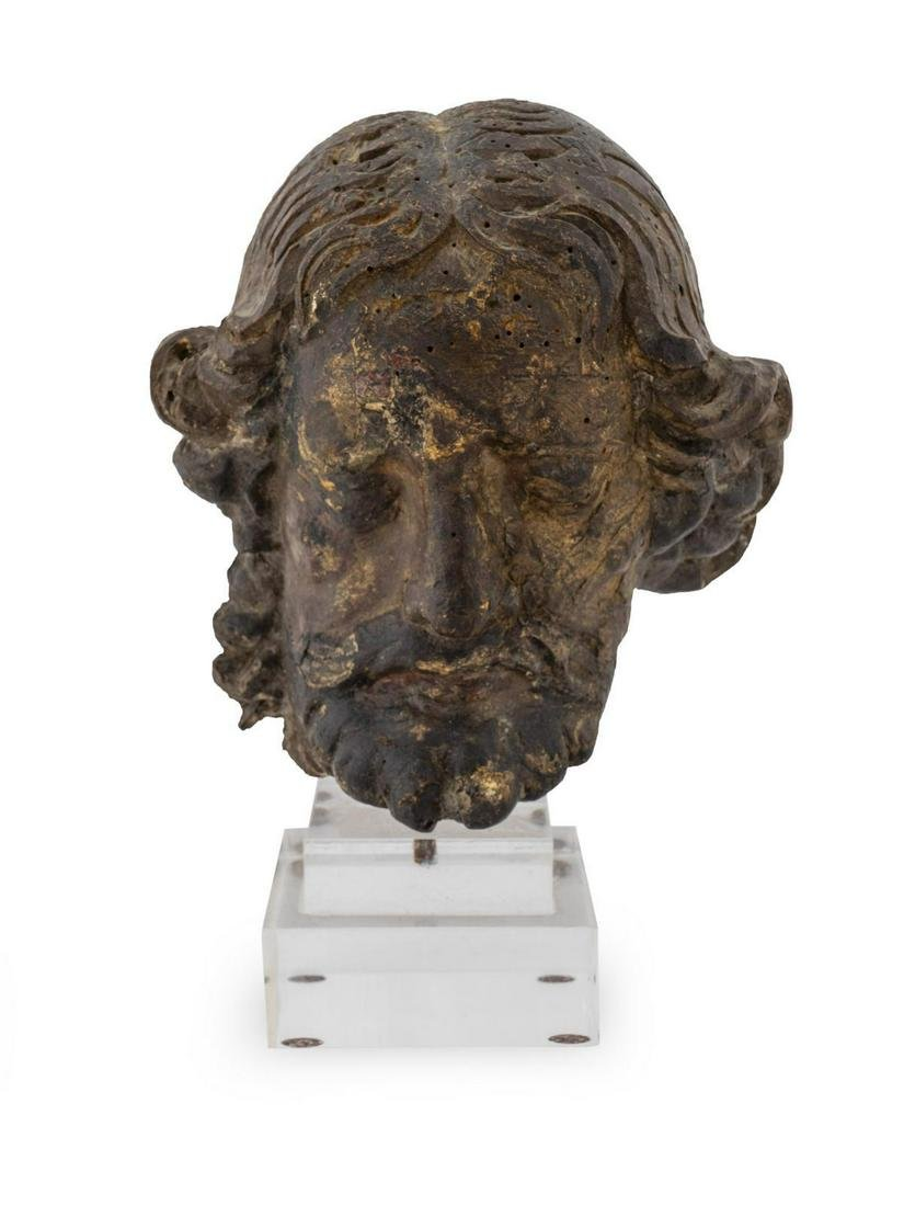 An Italian School Carved Wood and Partial Gilt Head of