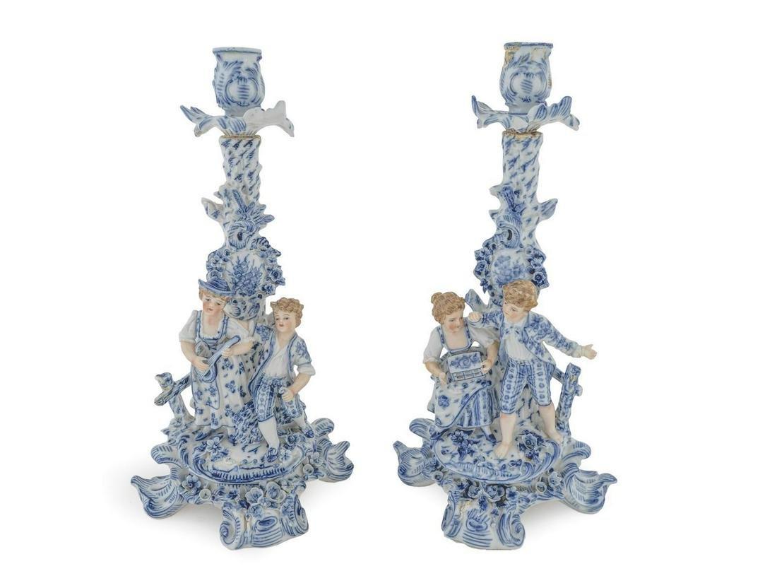 A Pair of German Porcelain Figural Candlesticks Height