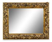A Continental Carved Giltwood Mirror