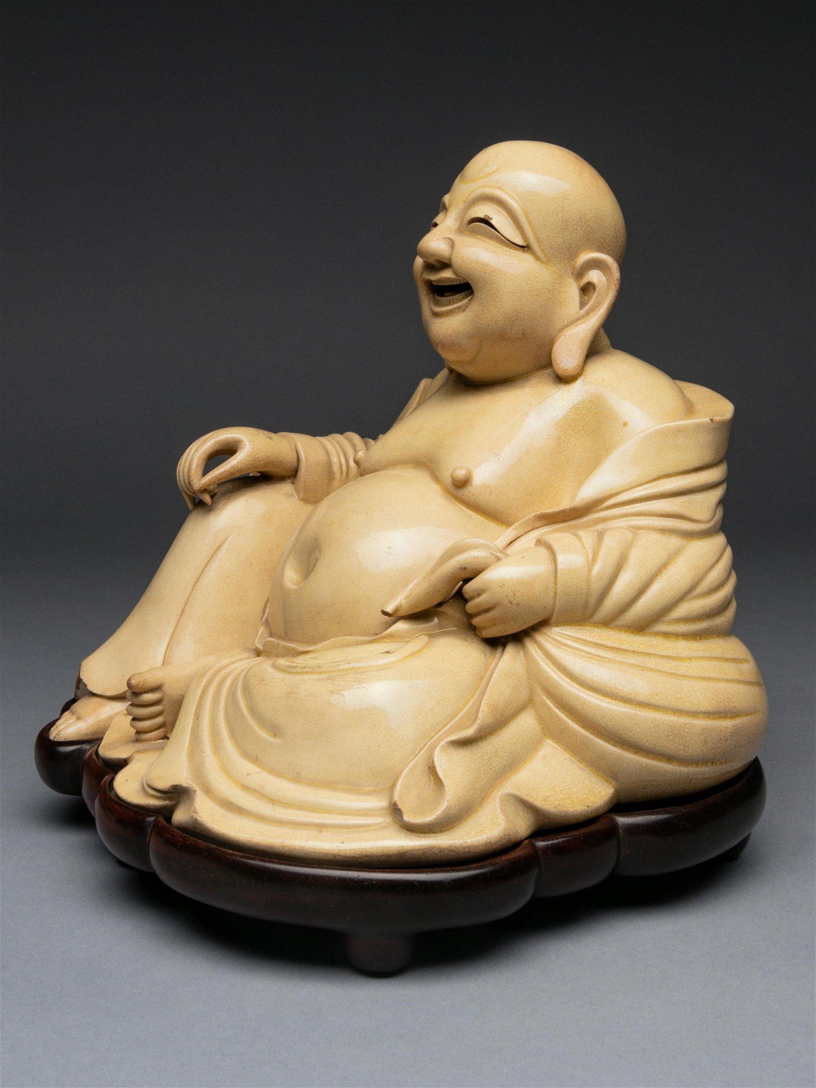 A White Glazed Figure of Budai Buddha Height 6 5/8 in.,