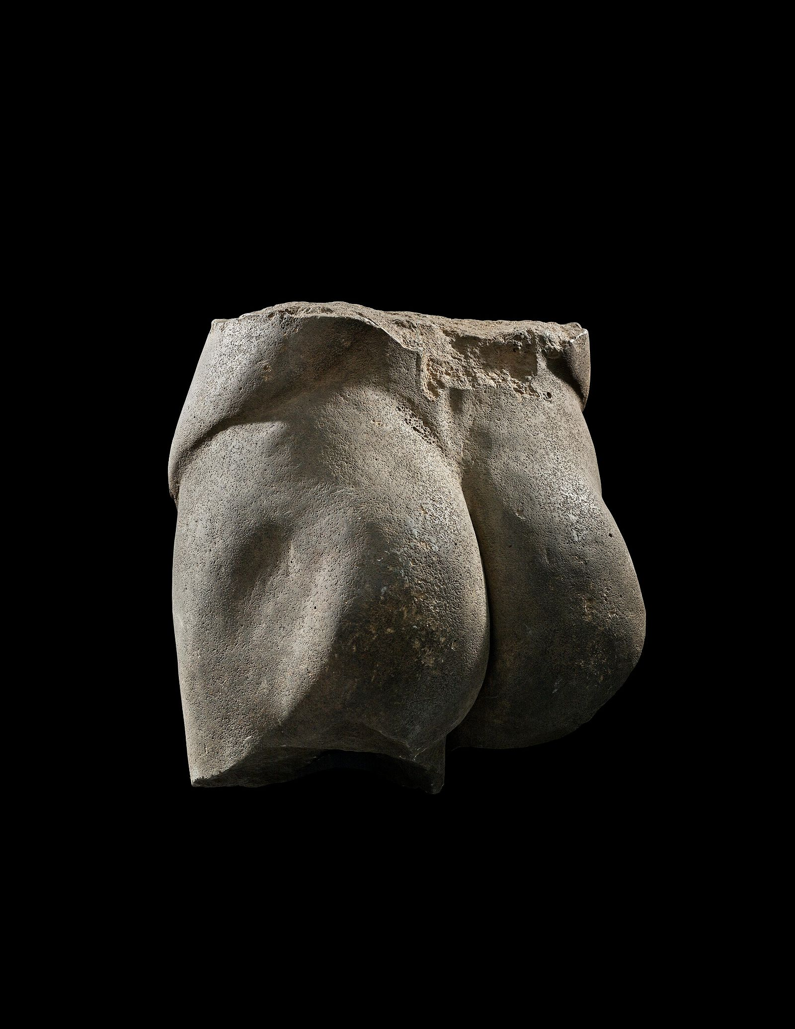 A Roman Basalt Lower Male Torso Height 16 1/2 inches.
