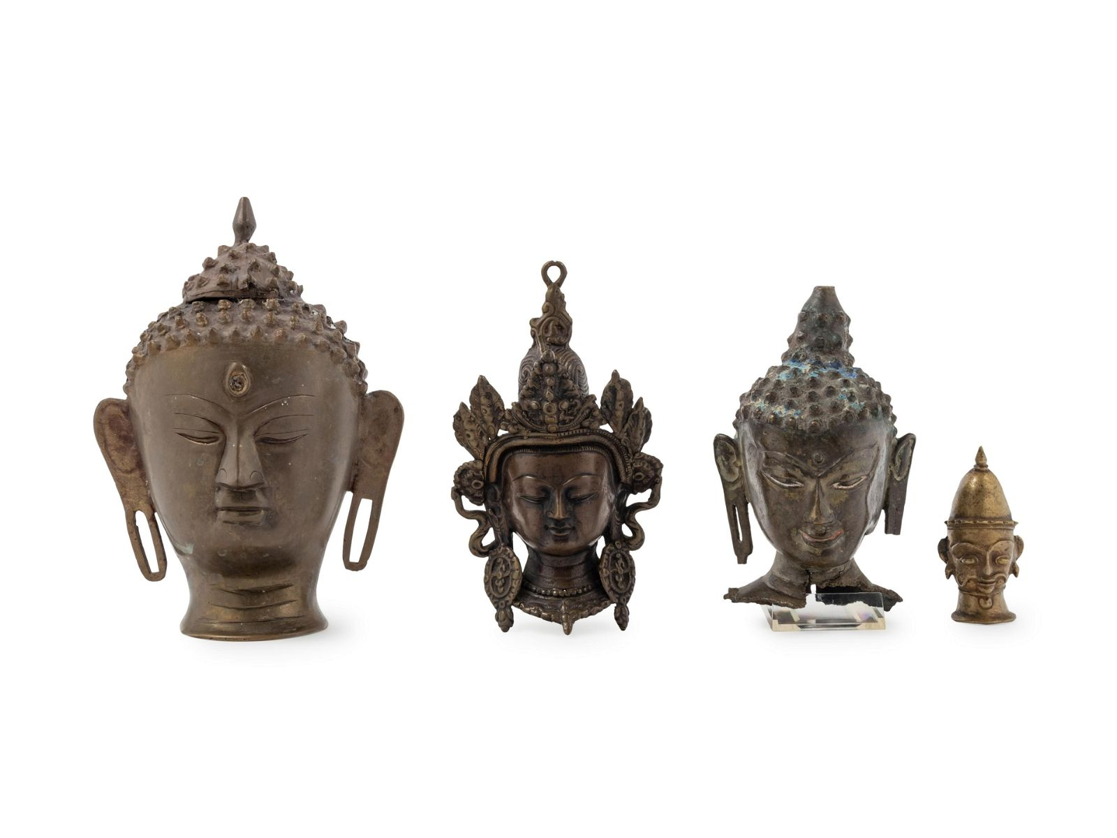 Four Southeast Asian Bronze Heads Height of largest 9