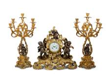 A Louis XV Style Gilt and Patinated Bronze Clock