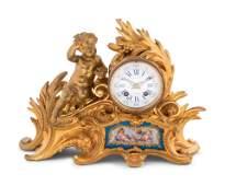 A Louis XV Style Porcelain Mounted Gilt Bronze Figural