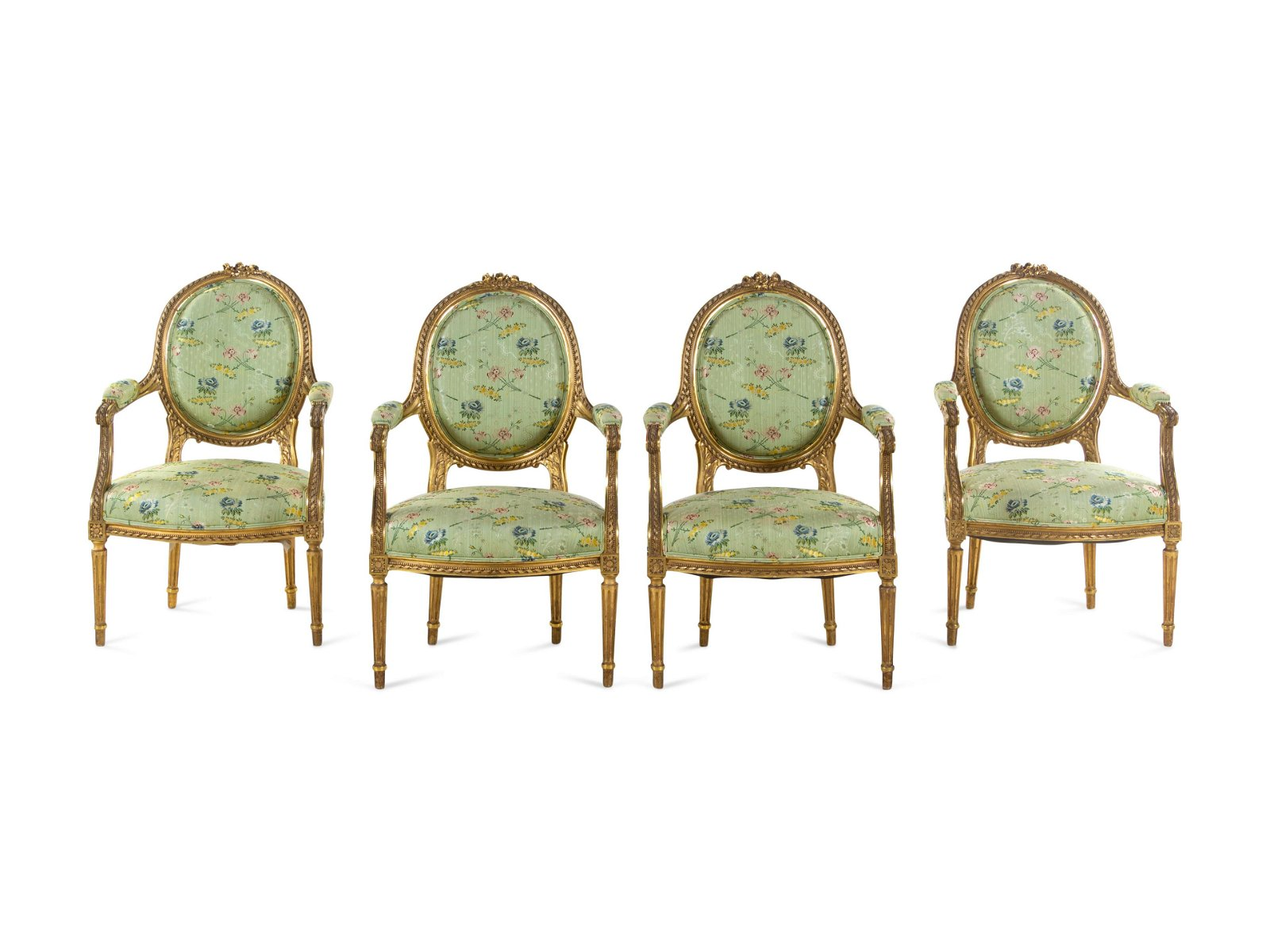 A Set of Four Louis XVI Style Carved Giltwood Fauteuils