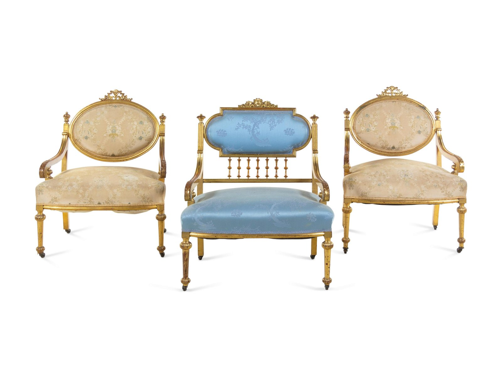 Three Louis XVI Style Carved Giltwood Fauteuils