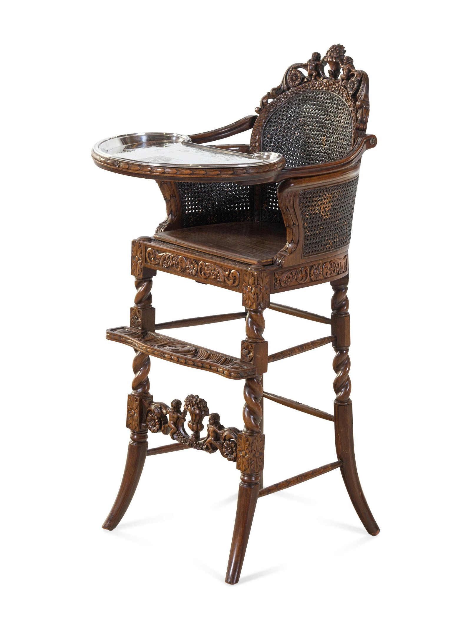 A Rococo Revival Carved Wood High Chair with a Fitted