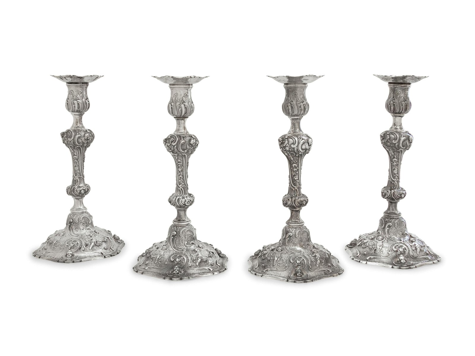 A Set of Four Rococo Revival Silver Candlesticks