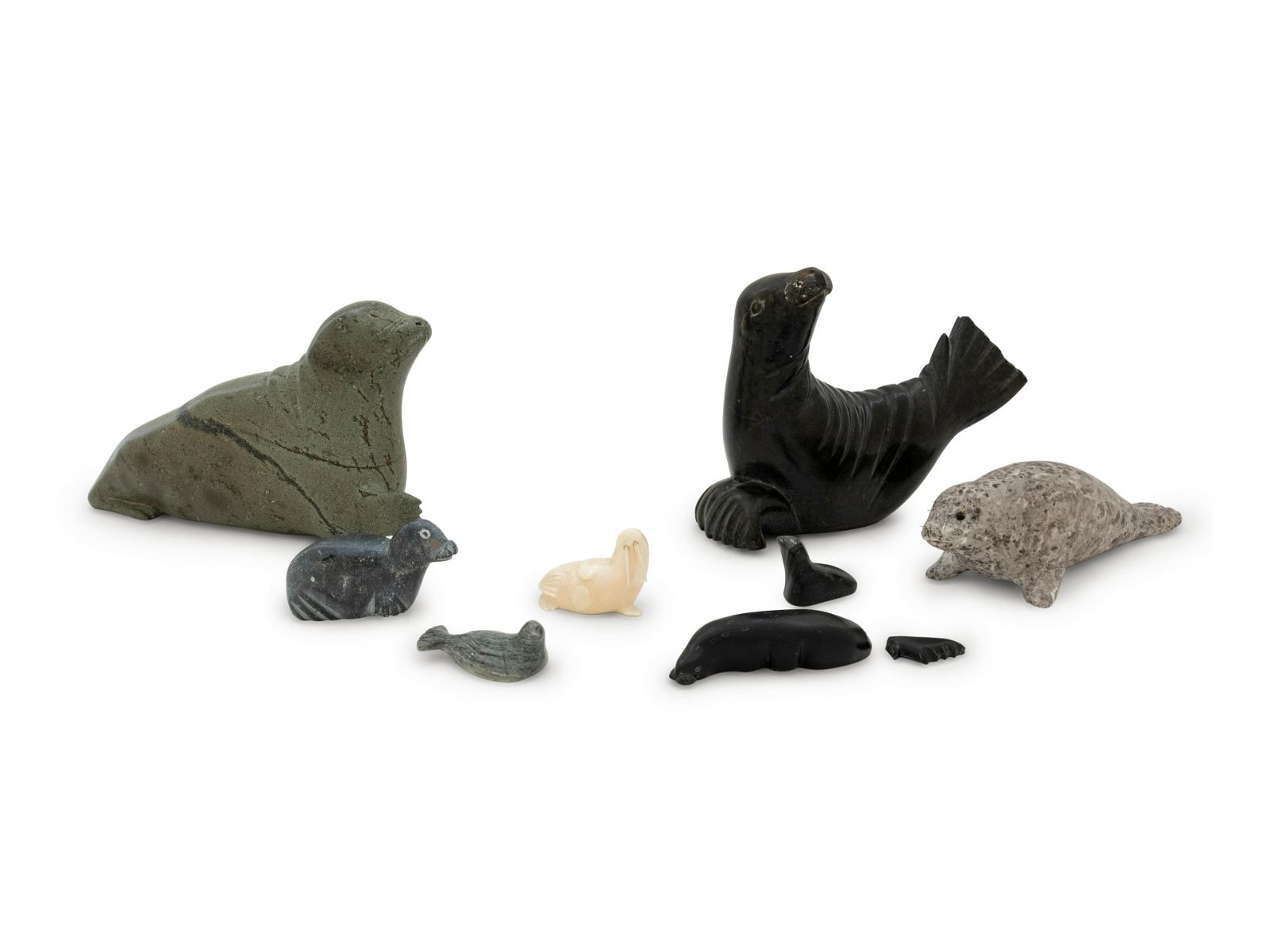 Eight Inuit Carved Stone Figures
