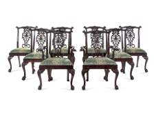 A Set of Eight George III Carved Mahogany Ribbon-Back