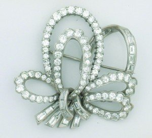 5: A Lady's Platinum and Diamond Brooch in a Bow Motif,