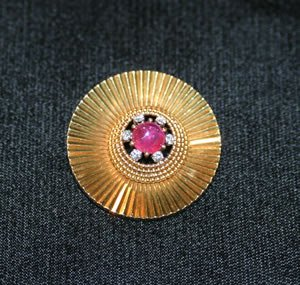 11: A Lady's 18 Karat Yellow Gold Ruby and Diamond Circ