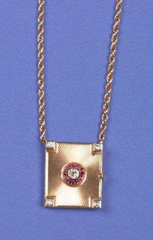 14: A Lady's 14 Karat Yellow Gold, Diamond and Ruby Loc