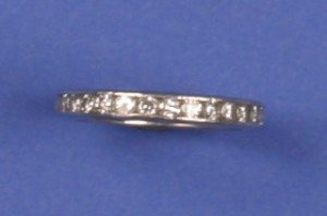 17: A Lady's Platinum and Diamond Eternity Ring,