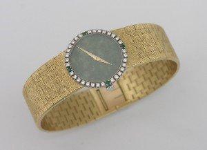 23: A Lady's 18 Karat Yellow Gold and Diamond Bracelet