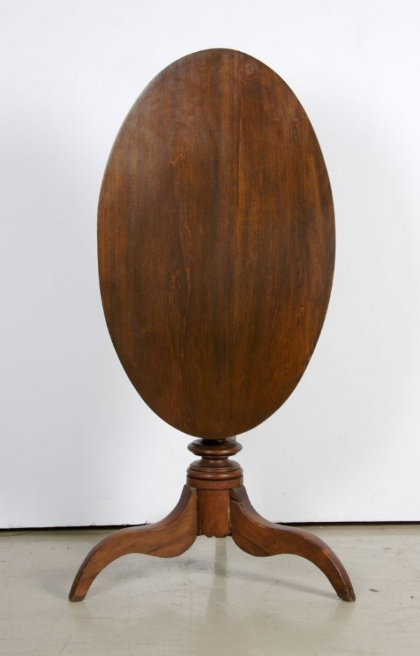 16: A Hepplewhite Tilt-Top Table, Height 47 1/2 inches.