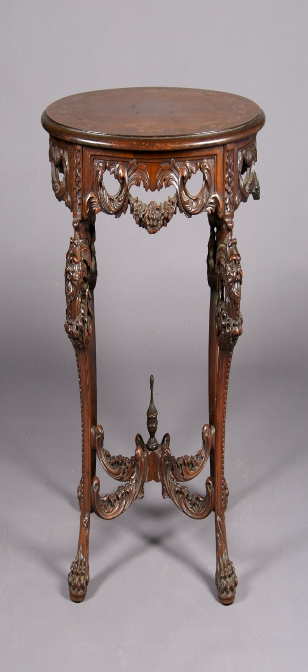 17: A Gothic Style Carved Figural Table, Height 30 1/2