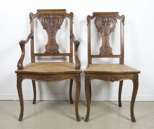 21: A Set of Ten French Walnut Chairs, Height 38 1/2 in