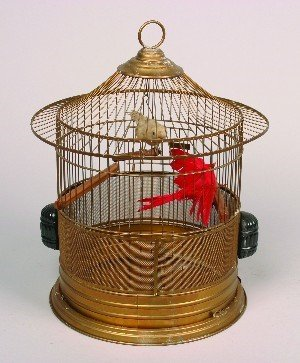 447: A Gilt Metal Birdcage, Height 18 inches.