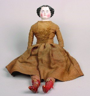 452: A Porcelain Head Doll. Height 24 inches.
