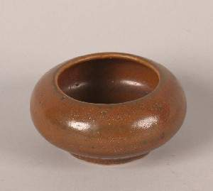 A Chinese Persimmon Glazed Ceramic Washer, Height