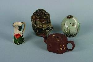 A Group of Asian Ceramic Articles, Height of tall