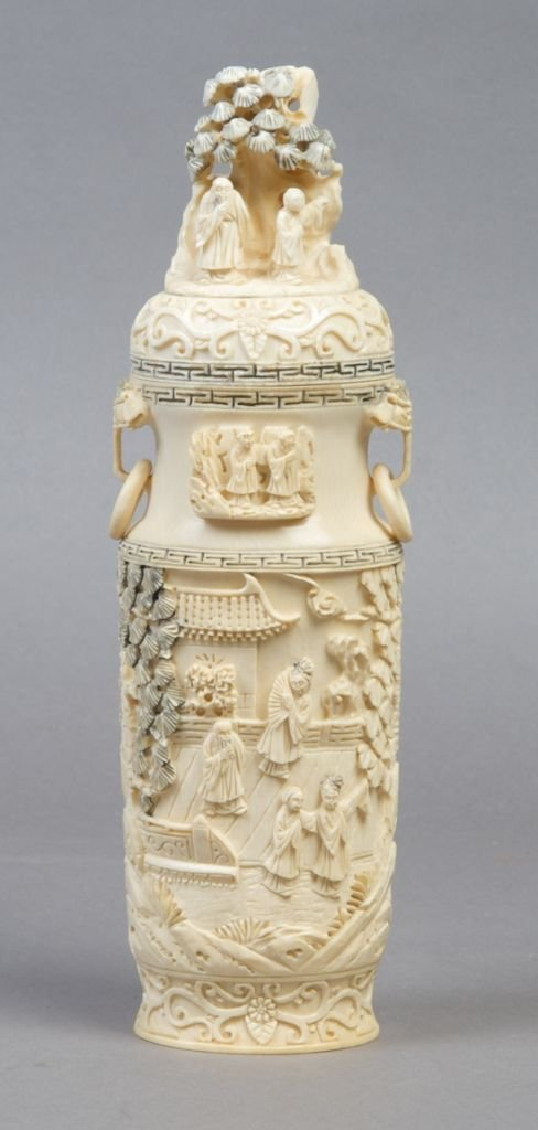 934: A Chinese Lidded Ivory Vase, Height 9 inches.