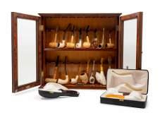 A Collection of Carved Briar Smoking Pipes