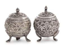 A Pair of Southeast Asian Silvered Metal Casters
