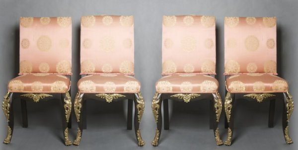 16: A Set of Four Continental Metal Mounted Side Chairs