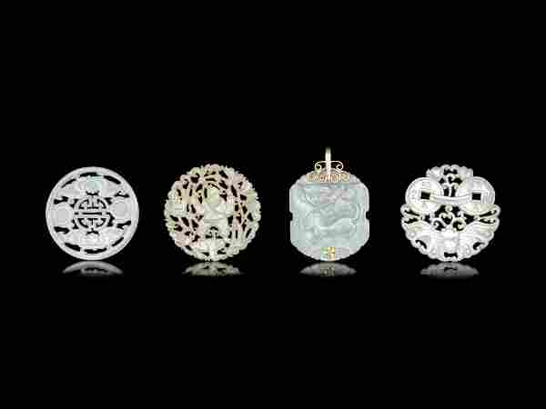 Four Chinese Jade and Serpentine Pendants
