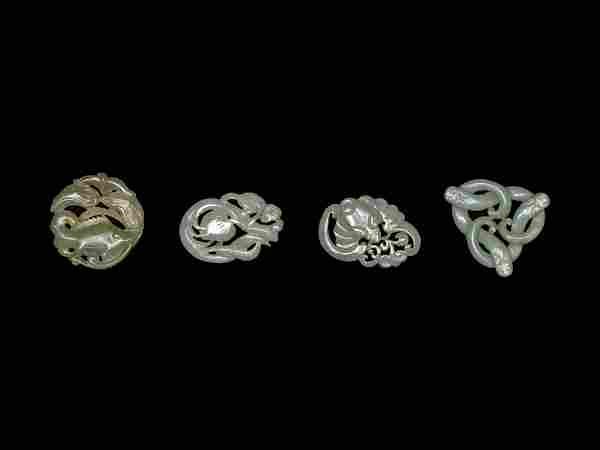 Four Chinese Celadon Jade Carved 'Animal' Pendants