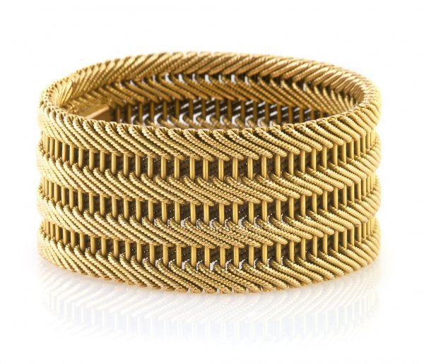An 18 Karat Yellow Gold Wide Mesh Bracelet. Length 7 in