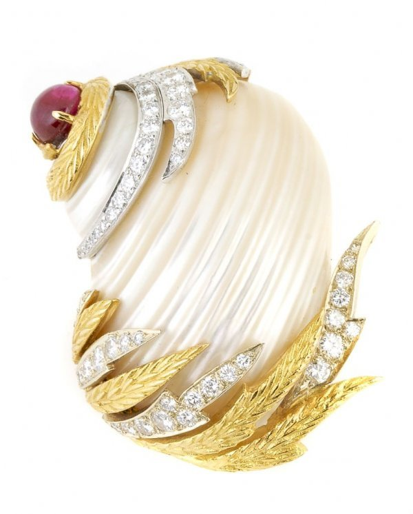 An 18 Karat Yellow and White Gold, Diamond, Ruby and Wh