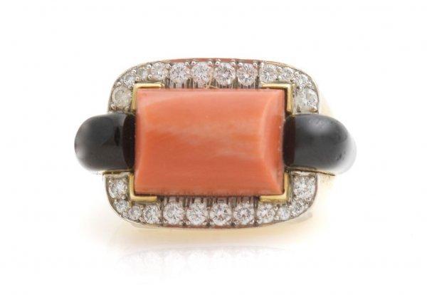 An 18 Karat Yellow Gold, Diamond, Orange Coral and Blac