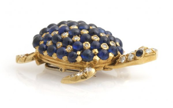 An 18 Karat Yellow Gold, Blue Sapphire and Diamond Turt