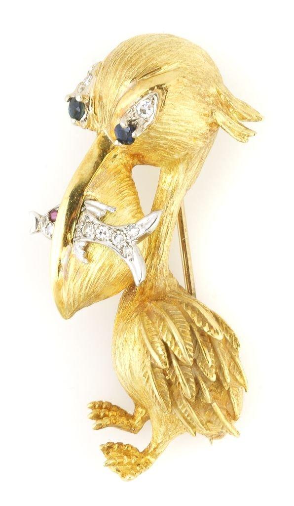 An 18 Karat Yellow Gold, Diamond, and Blue Sapphire Pel