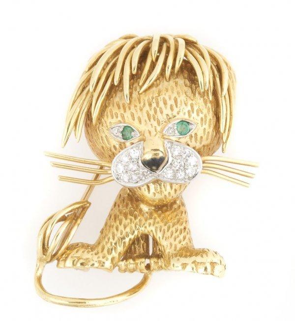An 18 Karat Yellow Gold, Diamond, and Emerald Lion Pin,