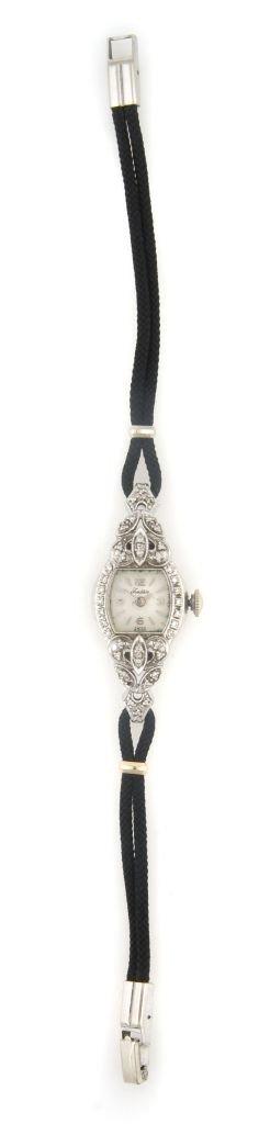 A 14 Karat White Gold and Diamond Wristwatch,