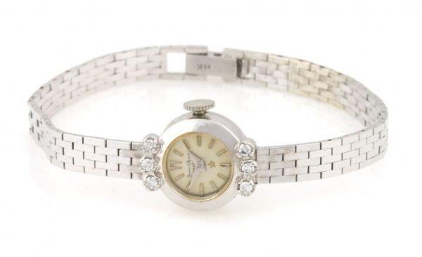 A 14 Karat White Gold and Diamond Wristwatch, Baume & M