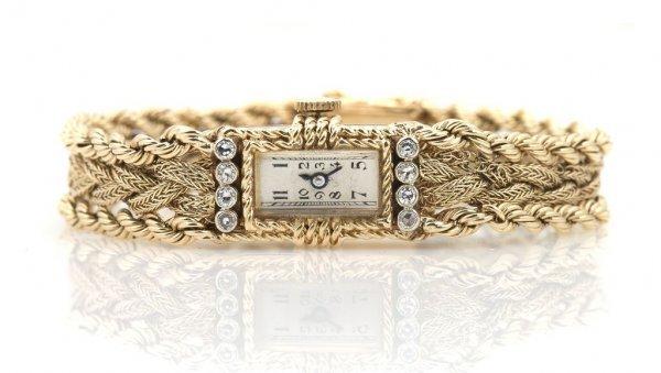 A 14 Karat Yellow Gold and Diamond Wristwatch, 16.65 dw