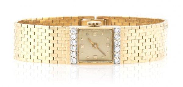 A 14 Karat Yellow Gold and Diamond Bracelet Watch,