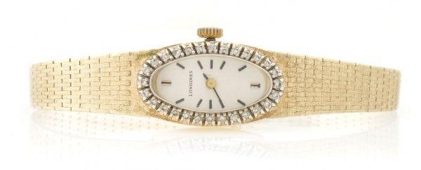A 14 Karat Yellow Gold and Diamond Wristwatch, Longines