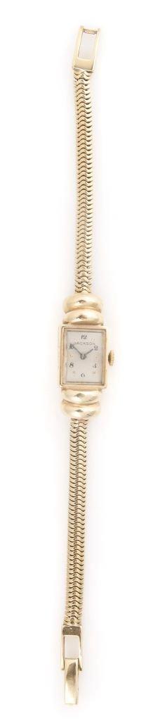 A 14 Karat Yellow Gold Wristwatch, Jackson,