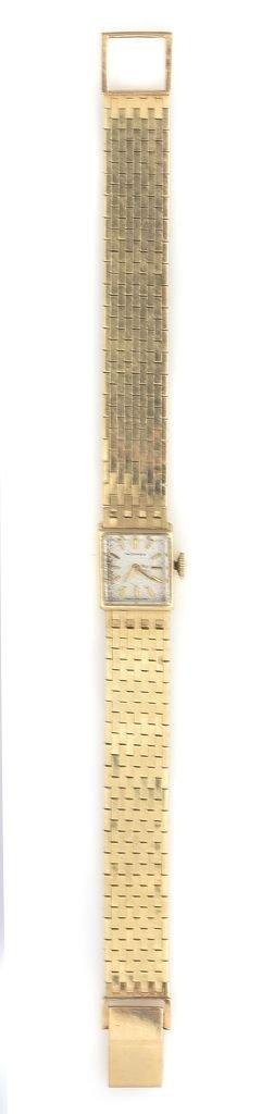 A 14 Karat Yellow Gold Wristwatch, Movado,