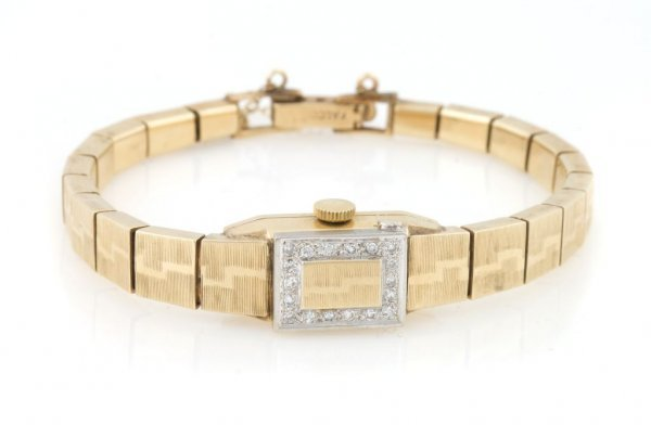 A 14 Karat Yellow Gold and Diamond Wristwatch, Incabloc