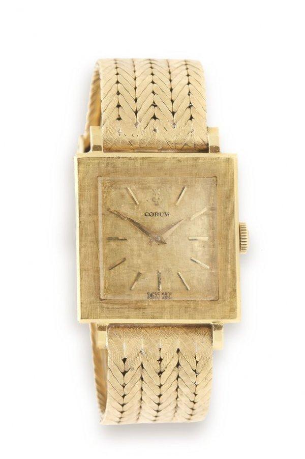 An 18 Karat Yellow Gold Wristwatch, Corum, Length 6 inc