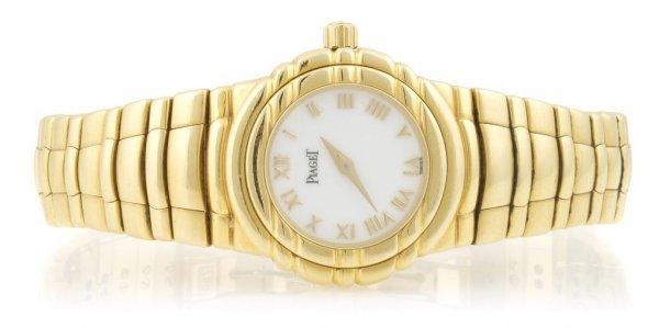 An 18 Karat Yellow Gold Wristwatch, Piaget Tanagra,